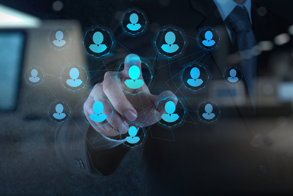 Double exposure of businessman hand points human resources, CRM and social media as concept-1